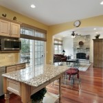 Kitchen in luxury home with view into family room